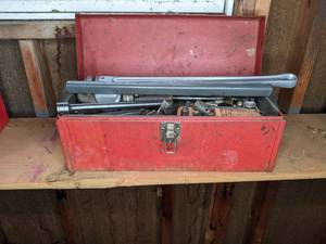 Vintage Metal Toolbox Brimming with Tools