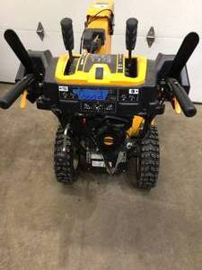 Cub CADET 2X 26 in. 243 cc Two-Stage Gas Snow Blower with Electric Start, Power Steering and Steel Chute in good conditions