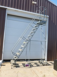 Cotterman 10' rolling ladder. Appears lightly used. Treads aren't even scuffed. As shown.