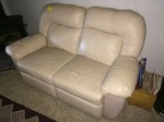 Leather Love seat / Recliner - still in excellent shape